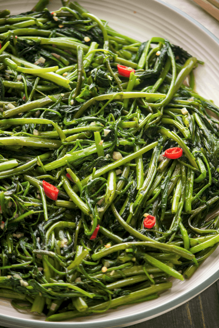 Stir Fried Water Spinach with Shrimp Paste on a plate.