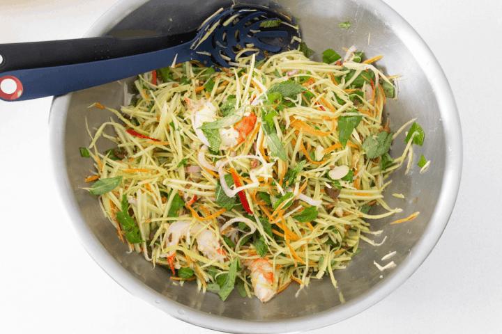 Vietnamese Mango Salad in a large mixing bowl.