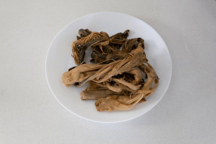 Dried mui choy on a plate.