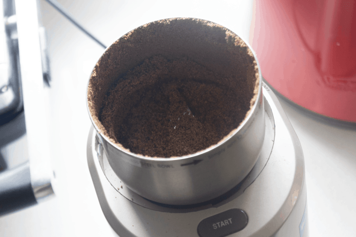 Ground peppercorns in a grinder.