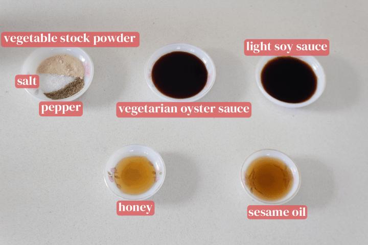 Dishes of salt, vegetable stock powder, pepper, vegetarian oyster sauce, light soy sauce, sesame oil and honey.
