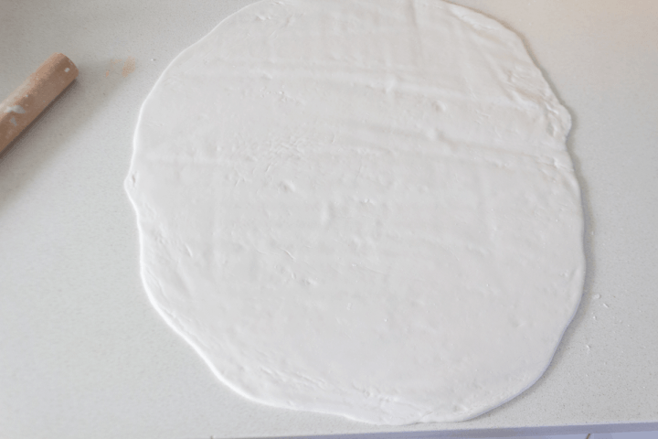 A large piece of flattened dough.