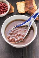 Red Bean Dessert Soup in a bowl with a spoon in it.