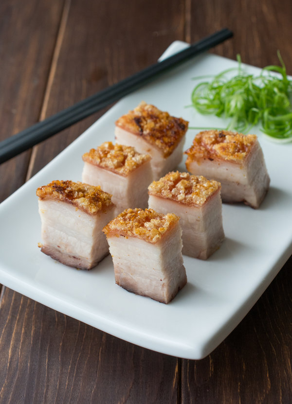 Crispy Roasted Pork Belly - extra crispy skin over super tender, flavorful meat. Best of all, really simple to make! Click on my page for a step-by-step walk-through!
