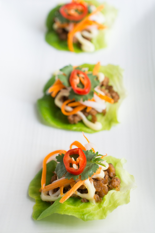 Inspired by Vietnamese Lemongrass Pork Bahn Mi Sandwiches, these Pork Bahn Mi Lettuce Wraps feature a lemongrass pork filling topped with creamy mayonnaise, pickled carrots and daikon, then topped with cilantro and fresh chili.