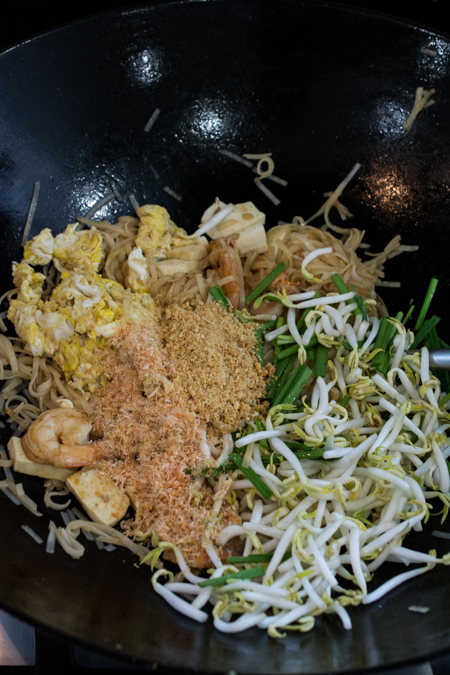 Authentic Pad Thai made easy! Rice noodles stir-fried in a slightly sweet and tangy sauce, topped with shrimp, sliced tofu, ground roasted peanuts, and fresh bean sprouts.