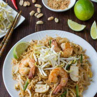 Authentic Pad Thai made easy! Stir-fried rice noodles in a slightly sweet and tangy sauce, topped with shrimp, sliced tofu, ground roasted peanuts, and fresh bean sprouts.