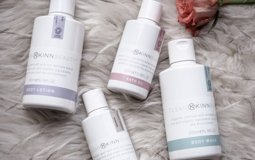 The KINN clean beauty range, including a body oil, bath oil, body lotion and body cleanser.