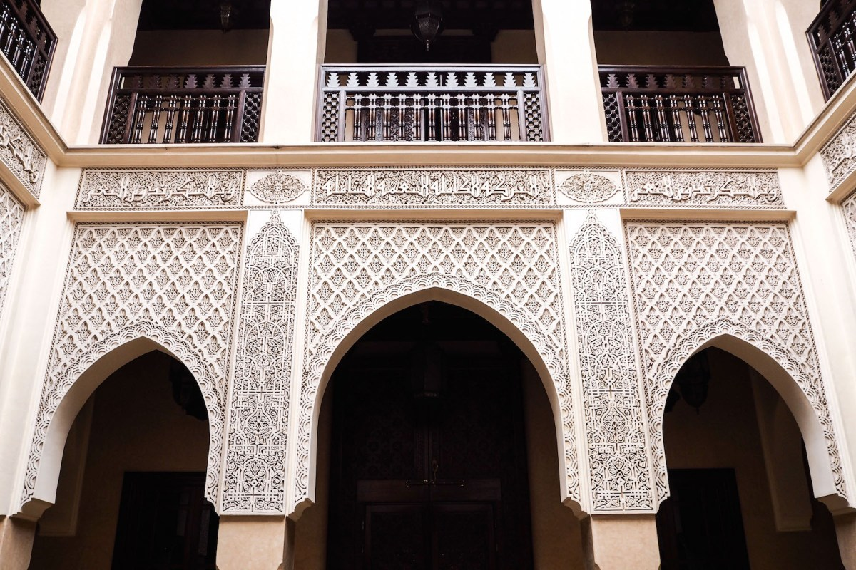Archways and tile details at Riad Kniza, Marrakech