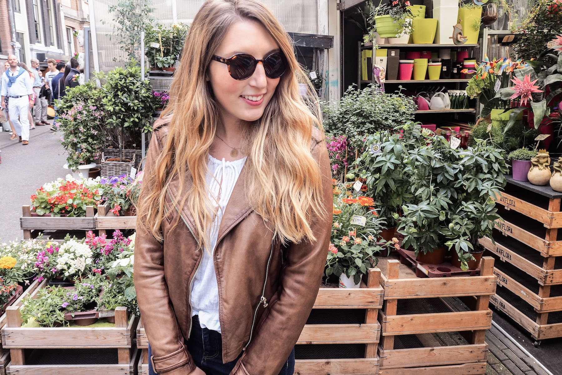 What I Wore in Amsterdam, Day 1: Massimo Dutti Leather Jacket, Urban Outfitters white blouse, H&M jeans, Soludos espadrilles, & Other Stories Sunglasses | Wolf & Stag