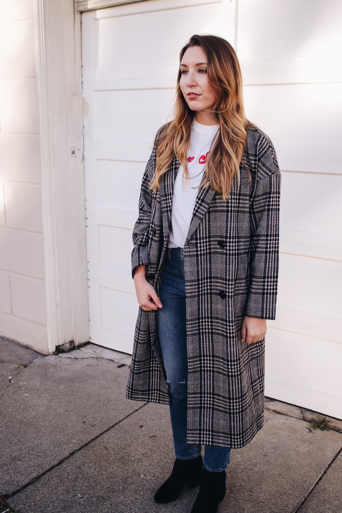 The Capsule Coat Edit | Featuring Madewell long checked coat, Ganni logo tee, Frame straight jeans and Sam Edelman black suede boots | Wolf & Stag