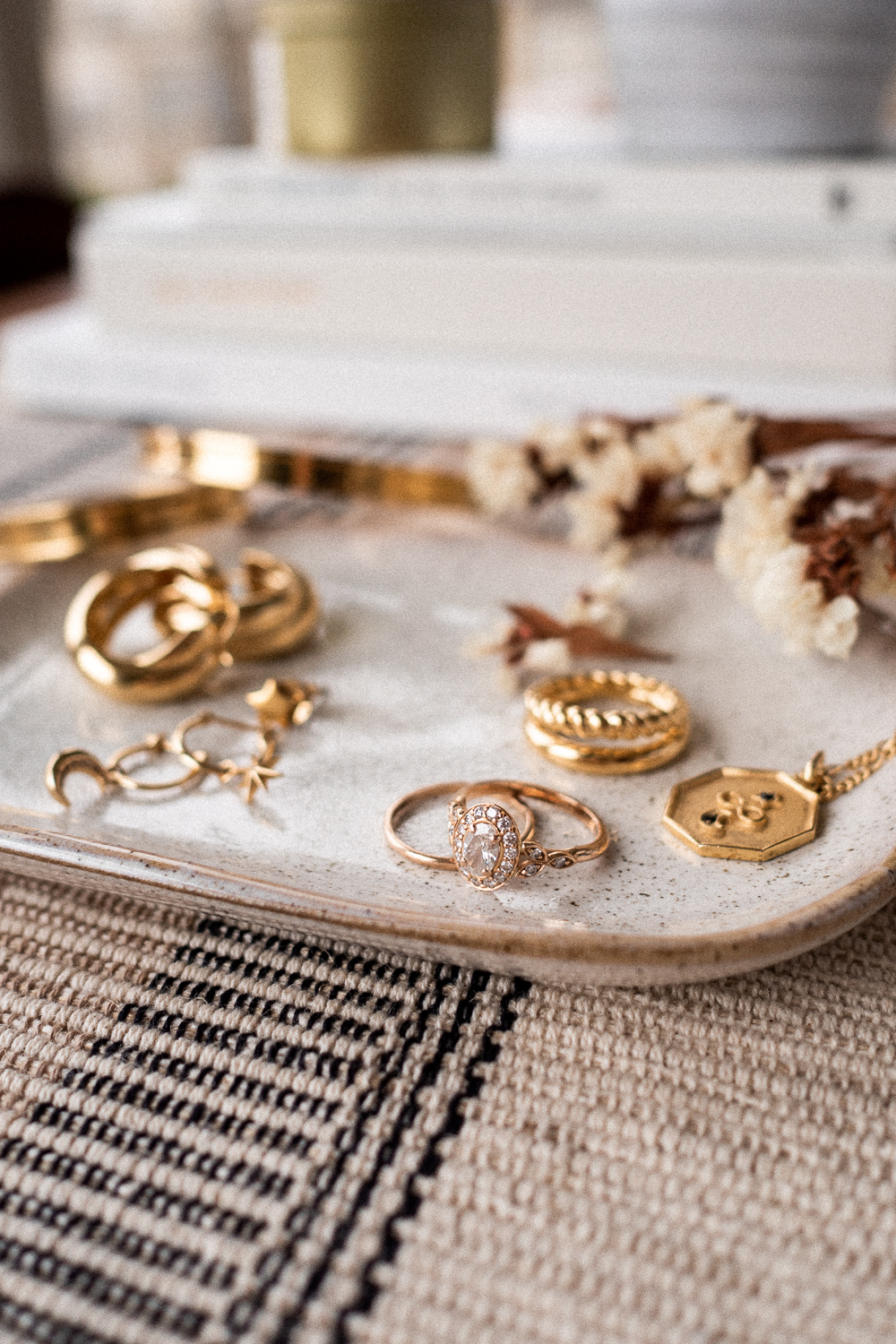 A closeup of gold and rose gold rings on a tray in my capsule jewelry collection