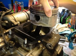 Cylinder head and barrel removed, the piston breathes fresh air. Notice the carbon deposit
