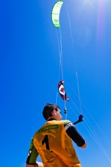 One of the kite pros on the beach between races