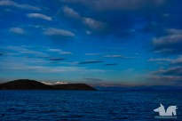 Distant snow capped mountains that surround the high altitude Lake Titicaca