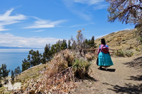 A local woman trekking between villages on Isla del Sol