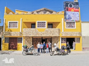Posing with the friendly owner of the hotel Oasisa Blanco in Uyuni