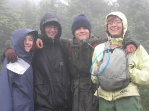 Four happy campers during our Alpine Trek backpacking adventure