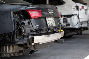 Rear and side of Audi needing auto body repair