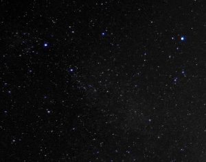 The constellation of Cygnus is on the left, and Lyra (with the brightest star, Vega), on the right