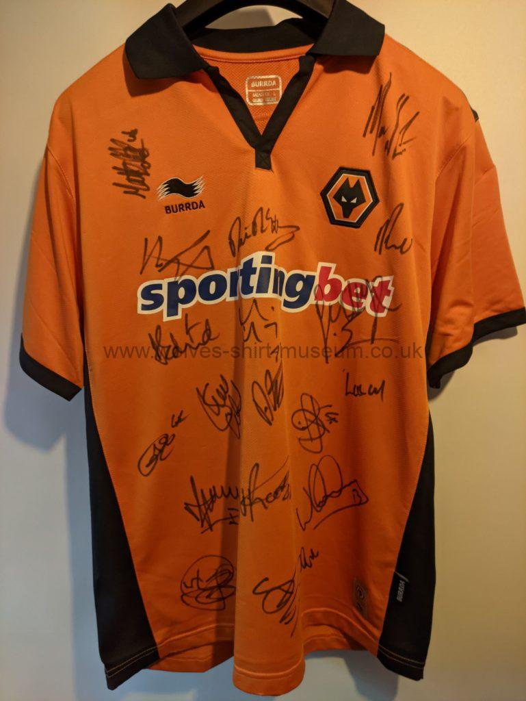 2010-2011 home shirt by Burrda signed by players