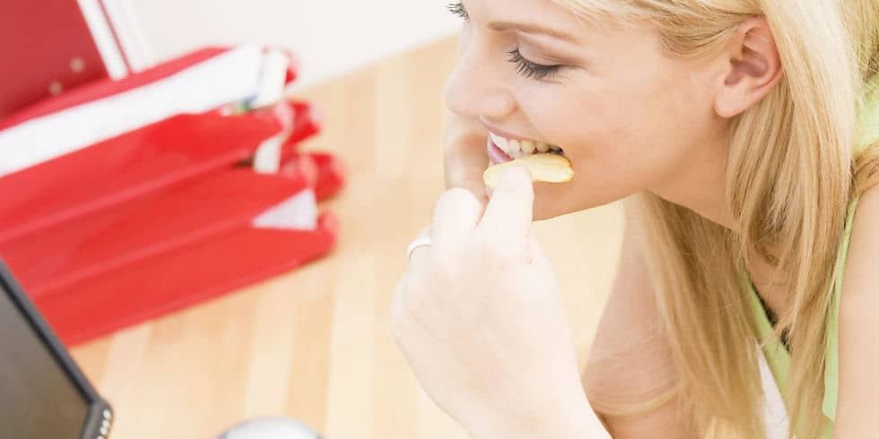 woman eating at desk