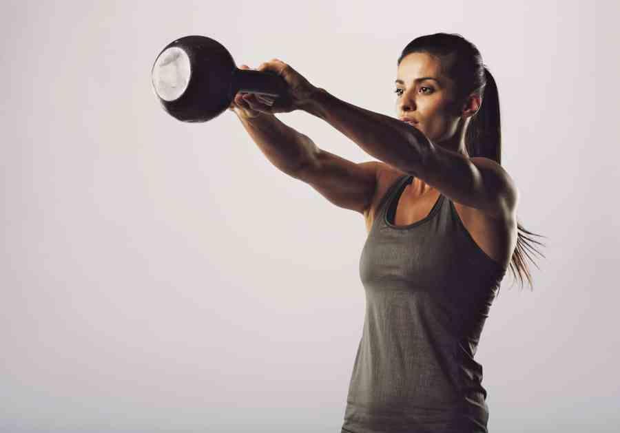 Female Doing Kettle Bell Exercise
