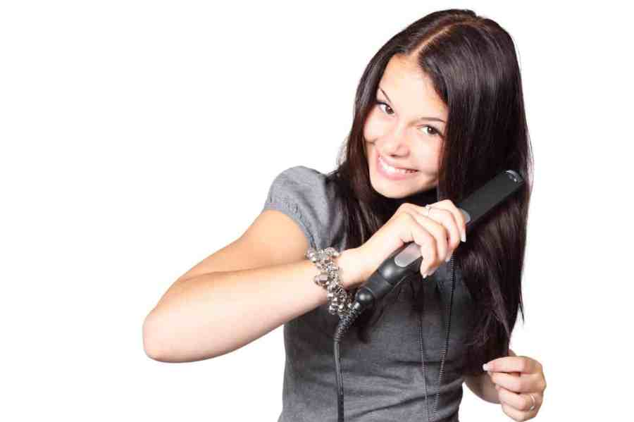 Woman_with_hair_straightener