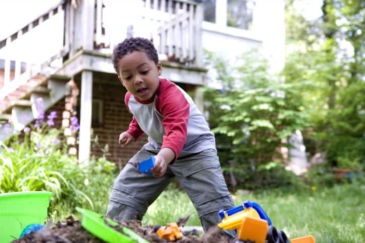 cute-african-american-boy-playing-in-backyard-725x483
