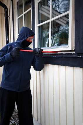Thief opening a window