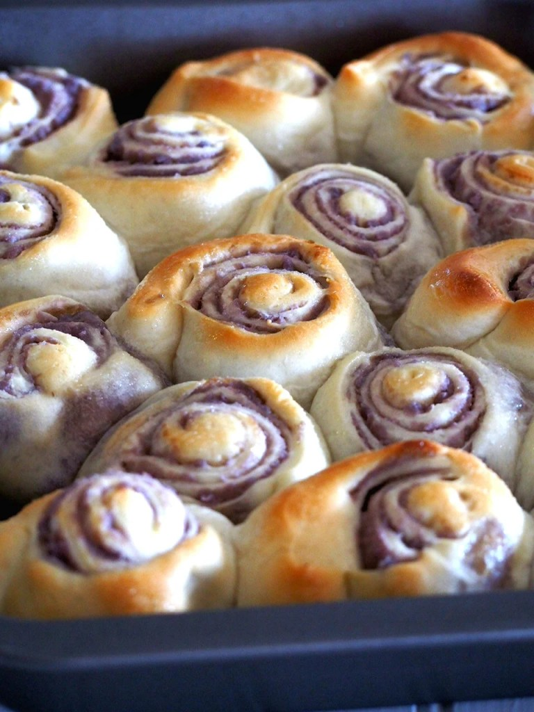 Ube bread rolls are soft rolls of bread filled with creamy and buttery ube ( purple yam).