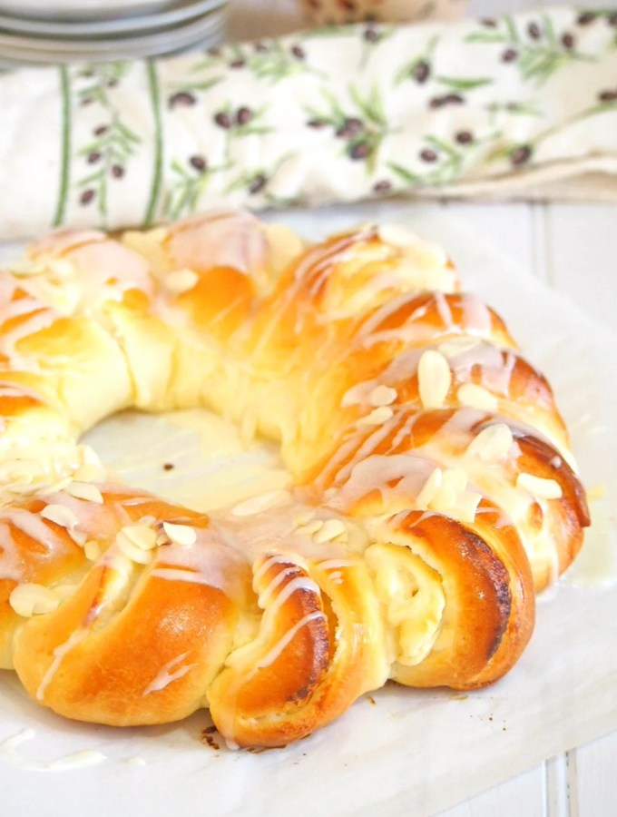Indulge on this  divine Brioche Bread Christmas Ring and be delighted by the soft and buttery brioche that is beautifully assembled and filled with honey stung cream cheese filling and studded with tender crisp almonds.