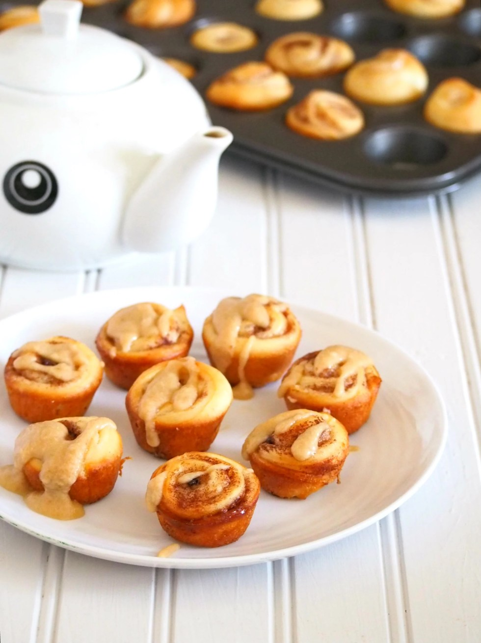 You will love these mini cinnamon rolls glazed with creamy coffee icing. these are so cute and small that you can pop them right into your mouth.
