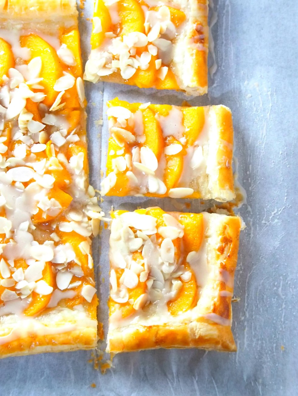 This peach tart is a delicious and easy peach dessert recipe that uses read-made puff pastry and yields a fresh, butteyr and flaky pastry dessert.