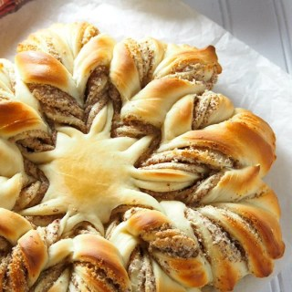 Almond Star Bread is a stunning piece of soft, tasty bread filled with sweet almond paste filling. This start shaped bread is a grand piece but it will be gone pretty fast!