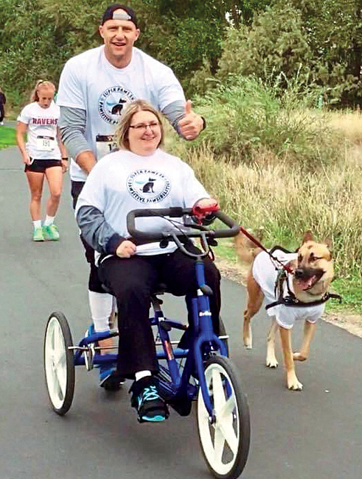 Amy helps raise funds for Pawsibilities with her service dog, Hero