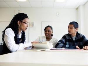 Student teacher help black classroom