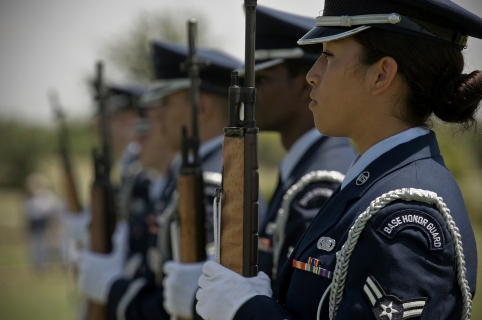 U.S. Air Force Airman 1st Class Twila Stone readies her weapon during a Memorial Day ceremony May 28, 2012, at the Texas State Veteran Cemetery in Abilene, Texas. Memorial Day is a day of remembering the men and women who died while serving in the United States Armed Forces. Stone is assigned to the 7th Logistics Readiness Squadron. (U.S. Air Force photo by Airman 1st Class Jonathan Stefanko)