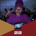 Guinan in purple outfit