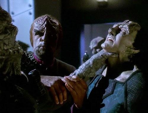 A Jem'hadar soldier chokes Garak in front of Worf
