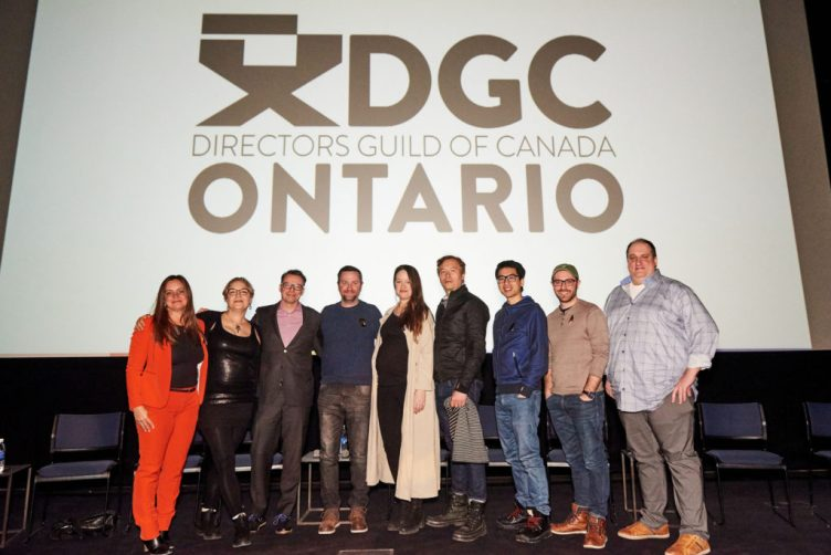 The panel stands in front of the Directors Guild of Canada: Ontario logo