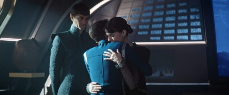 Amanda tearfully embraces Michael as Sarek watches