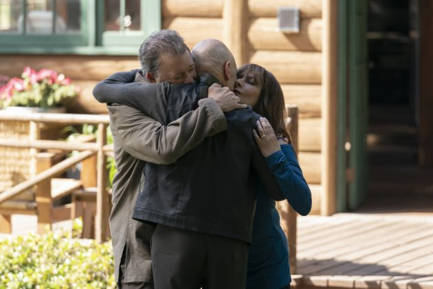 Riker, Picard and Troi hug goodbye
