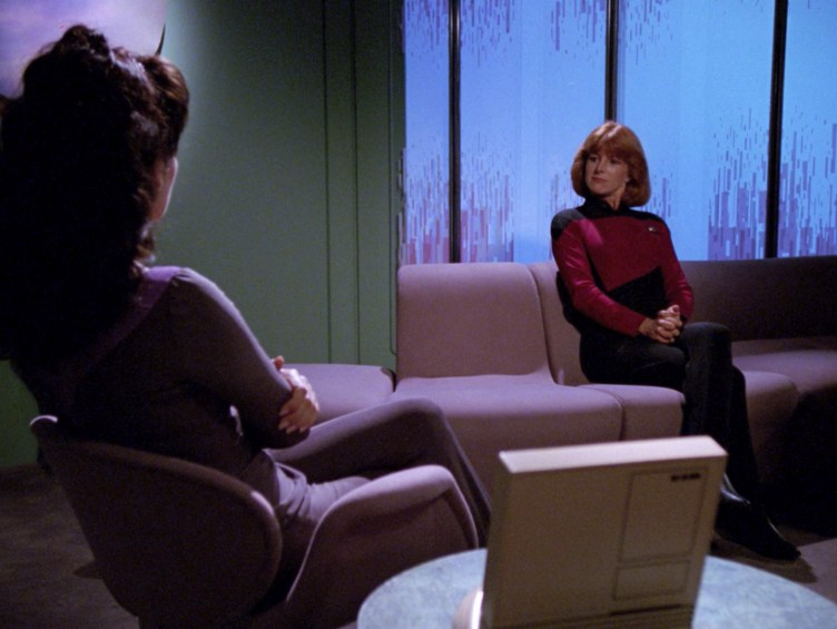 """Troi speaks with her client in """"The Loss"""""""