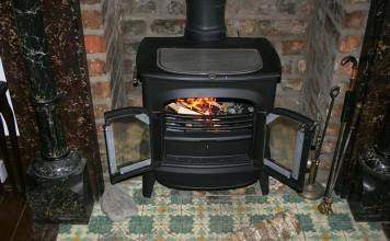 How to Operate Your Wood Stove More Efficiently, how to use a wood burning stove to heat a house, how to keep wood stove burning all night, how does a wood stove heat a house, using a wood burning stove for the first time, wood burning stove tips and tricks, how to use a wood stove damper, wood burning stove controls, how to keep a wood burner going,