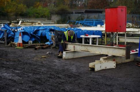 Dismantled stand now at Featherstone and work begins.