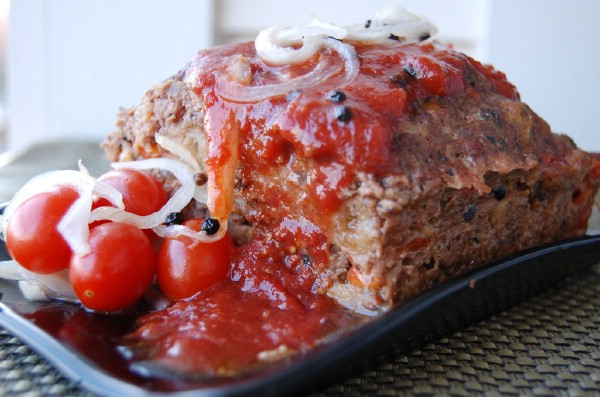 decorated roasted red pepper meatloaf with pickled tomatoes