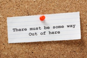 "Notecard on bulletin board reading ""There must be some way out of here"""