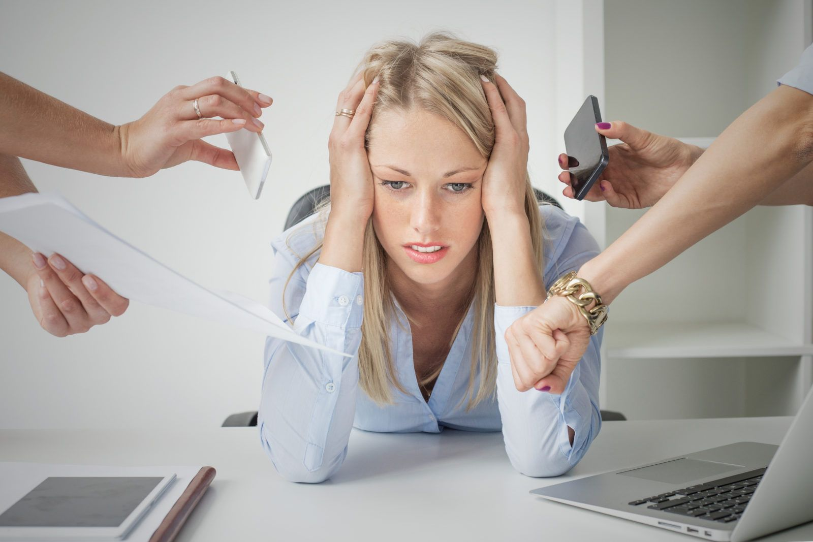 Pressure at work: depressed business woman
