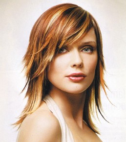 women medium layered hairstyle with long side bangs